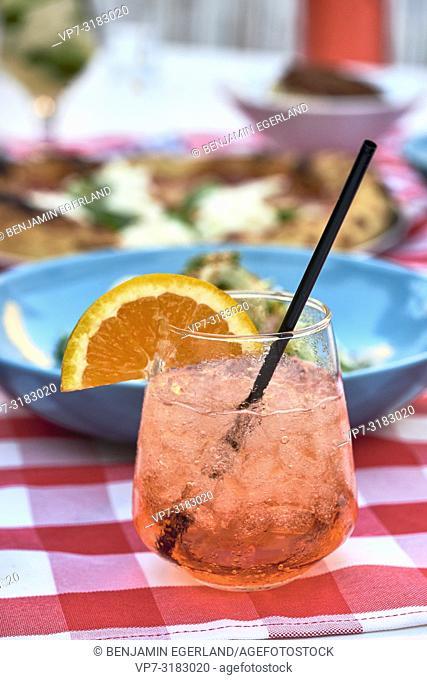red cocktail with orange at Mad Pizza e Bar Chersonissos, Crete, Greece