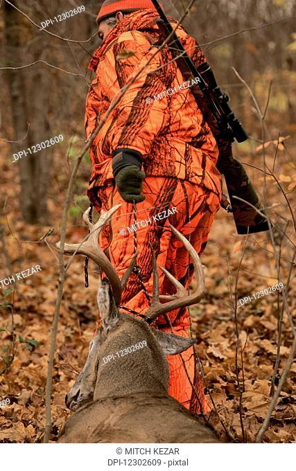 Deer Hunter With Dead Deer