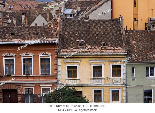 Old architectural building facades and rooftops in the town of Brasov, Romania, Eastern Europe