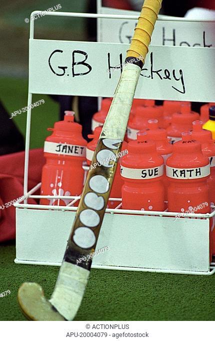 Field hockey stick by team water bottles