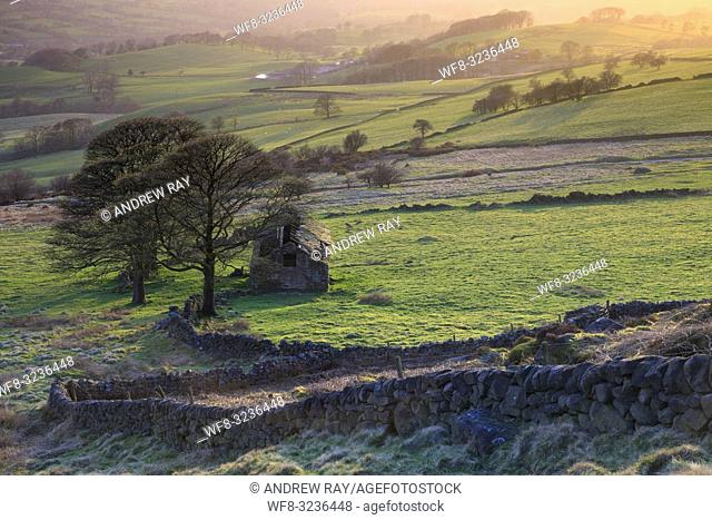 The barn at Roach End in the Peak District National Park captured from a high vantage point on an evening in late April