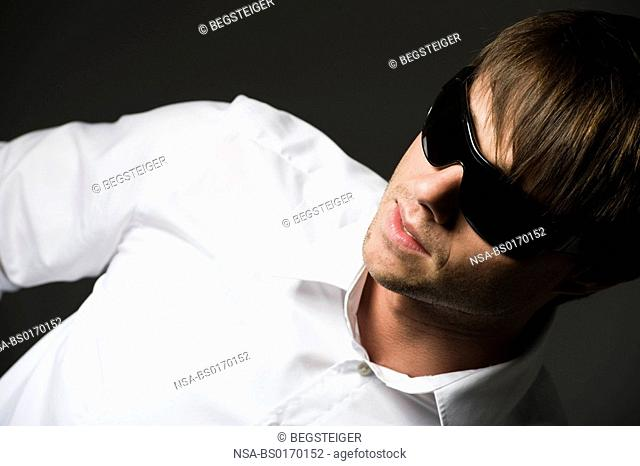 man in white shirt with black shades