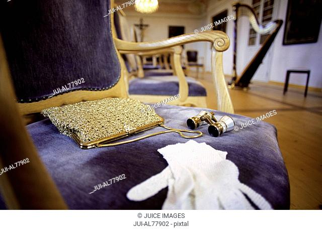 Purse, gloves and opera glasses on chair, Monastery Andechs, Bavaria, Germany