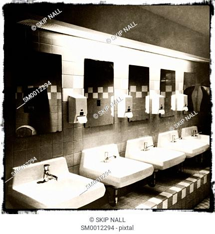 A line of sinks in a bathroom