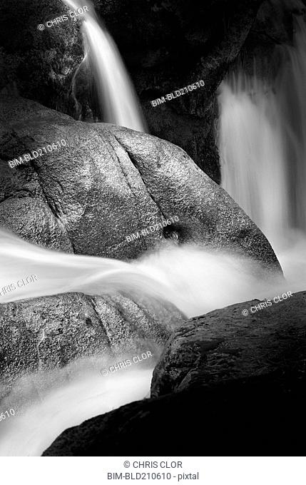Water pouring over rock formations