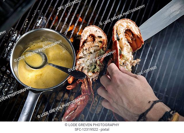 Lobster with sauce on a grill