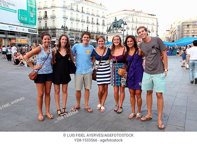 Young tourists posing in the Puerta del Sol, Madrid, Spain, Europe
