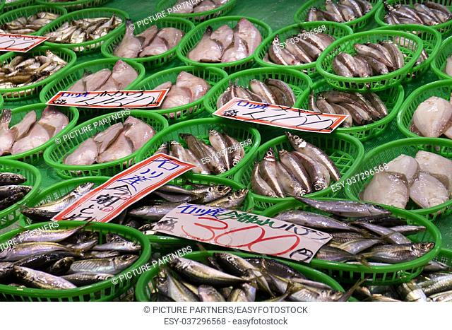 Fresh seafood in green plastic baskets at the Omicho Market