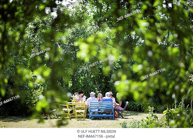 A family having a meal in the garden Sweden