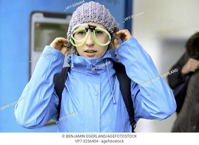 woman wearing funny eyeglasses, in Munich, Germany