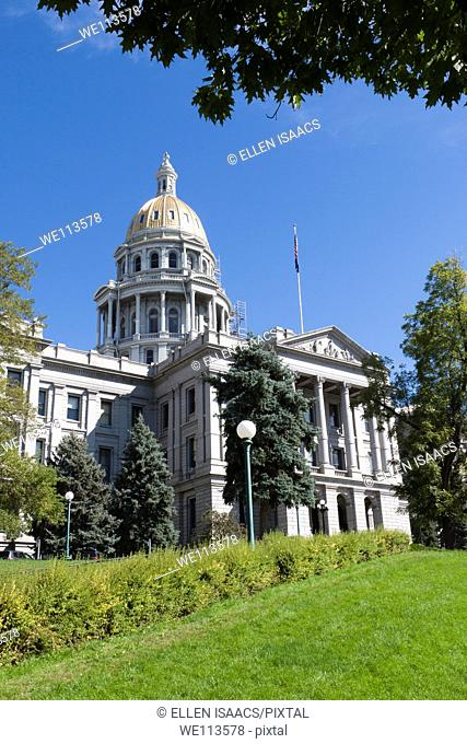 Gold dome and flag above Colorado state capitol building in Denver