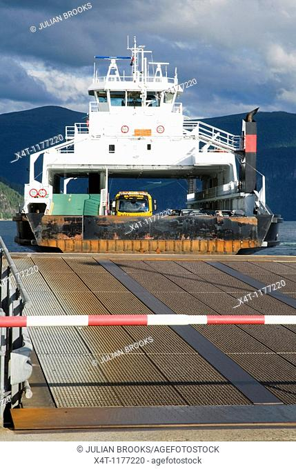 Ferry arriving at Lote in Western Norway  Summer, laden with cars and commercial vehicles