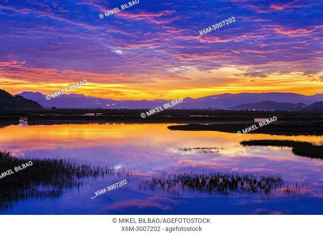 Salt marshes at dusk. Cerroja water mill. Santoña, Victoria and Joyel Marshes Natural Park. Cantabria, Spain, Europe