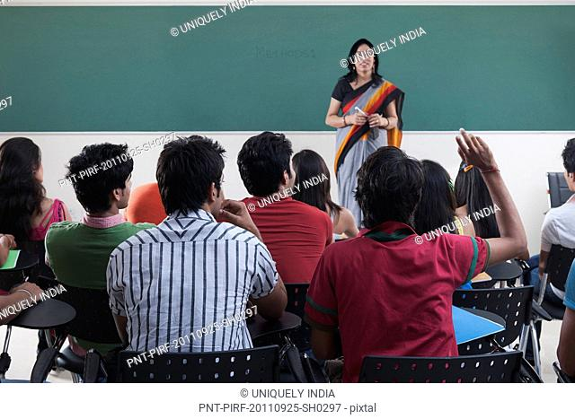 Female lecturer teaching in a classroom