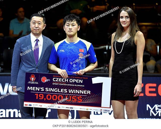 Men's singles winner ZHENG Peifeng of China holds award after the ITTF WORLD TOUR in Olomouc, Czech Republic, August 26, 2018