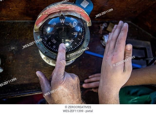 Fishermen checking compass
