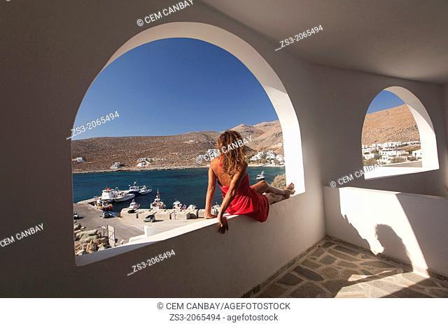Woman sitting at the balcony, Folegandros, Cyclades Islands, Greek Islands, Greece, Europe