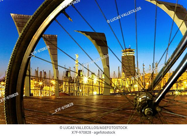 Barcelona: Waterfront across the wheel of bike  As seen from Odissea square in Maremagnum shopping mall