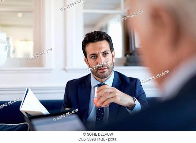 Businessmen talking in restaurant