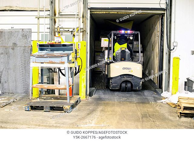 New York City, USA. Forklift unloading a delivery truck at the New Fulton Fish Market at Hunts Point, The Bronx