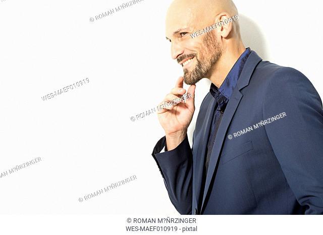 Bald man with beard wearing blue shirt and jacket