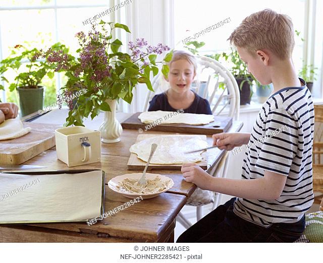 Boy and girl preparing cake