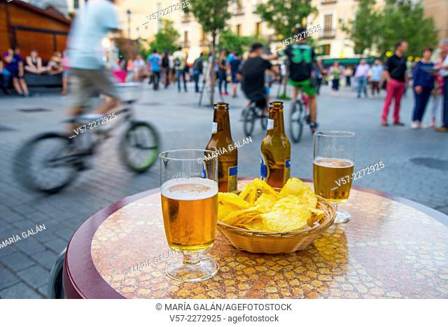 Two glasses of beer and chips on a terrace. Isabel II Square, Madrid, Spain