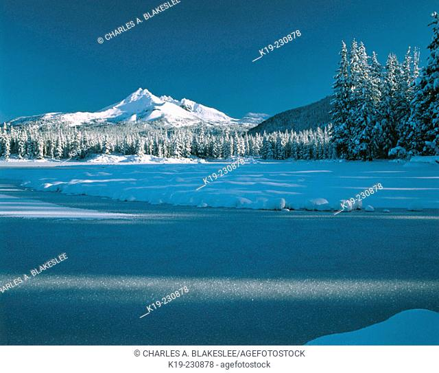 Early winter snow covers Broken Top and Sparks Lakes. Deschutes National Forest. Oregon. USA