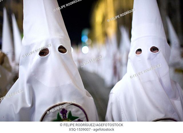 Close up of young hooded penitents, Holy Week, Seville, Spain
