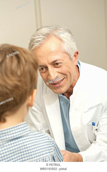 Doctor smiling at boy
