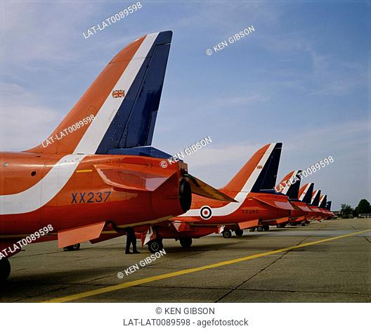 The Red Arrows are the RAF aerobatic aerial display team flown by pilots from the Royal Air Force. The jet aircraft are painted red and white with blue tails