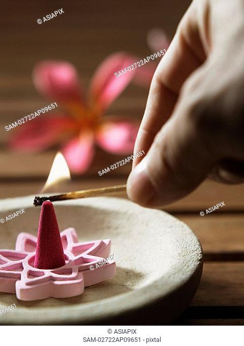 lighting up incense burner