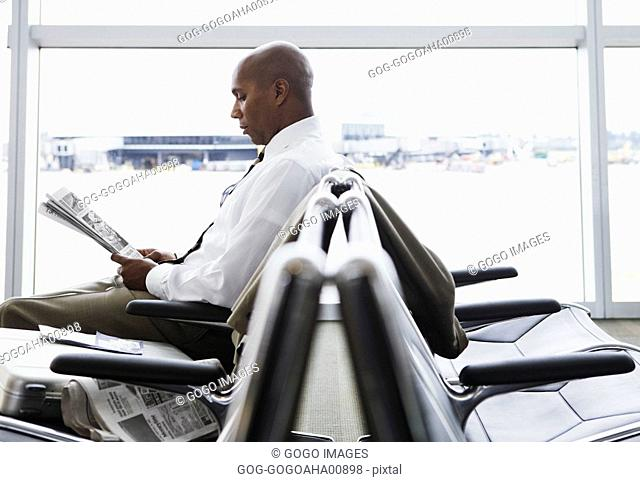 African businessman in airport waiting area