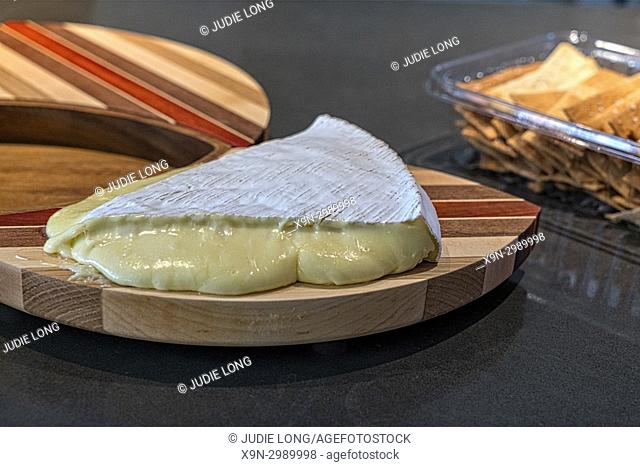 A Wedge of French Brie Cheese, Room Temperature, Crackers in the Background,NYC