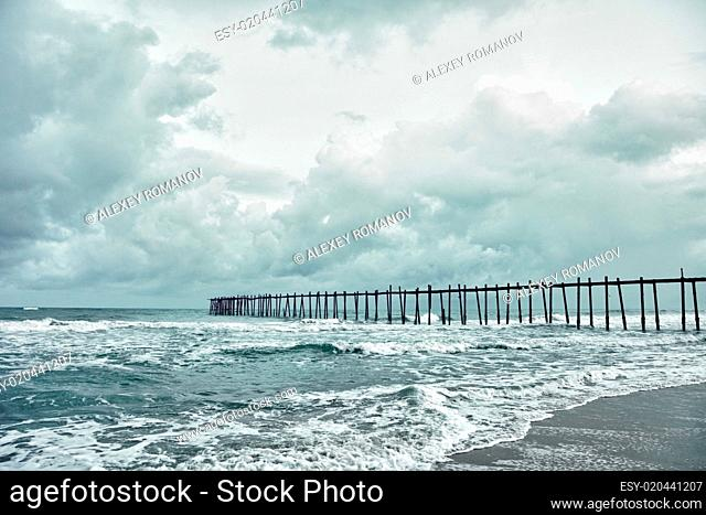 Old jetty over the stormy sea