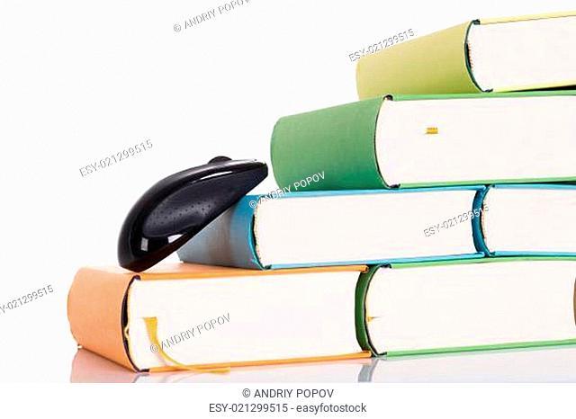 Computer mouse climbing books