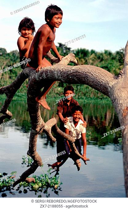 Children playing in the Orinoco River. The Warao are an indigenous people inhabiting northeastern Venezuela and western Guyana