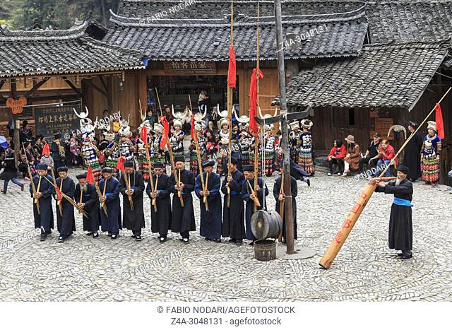 People of the Miao ethnic minority performing a traditional dance in Langde Miao Nationality village, Guizhou province, China