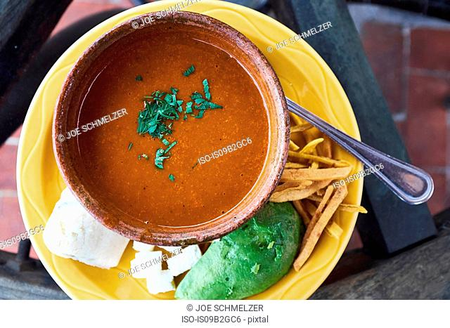 Overhead view of bowl of fresh soup with herb garnish, Antigua, Guatemala