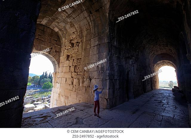 Tourist on a passageway leading to the ancient amphitheater of Miletus, Milet, Aydin Province, Turkey, Europe