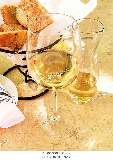 A glass of wine and home-made bread