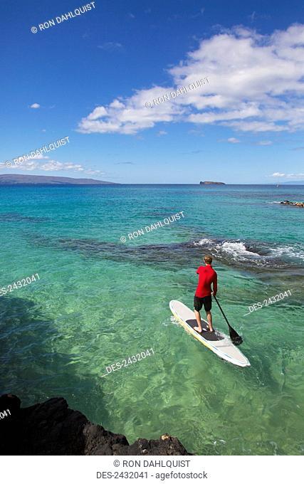 Man stand-up paddleboarding; Makena, Maui, Hawaii, United States of America