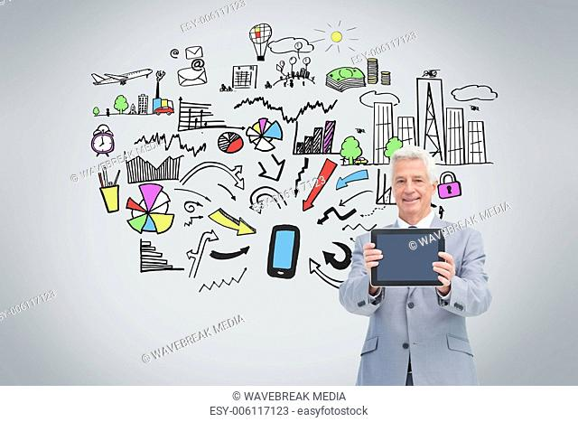 Mature businessman showing his tablet