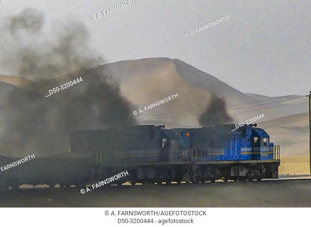 "Freigh train in the desert. The TransNamib Railway """"Desert Express"""" between Windhoek and Swakopmund, hauled by two General Electric U20C"