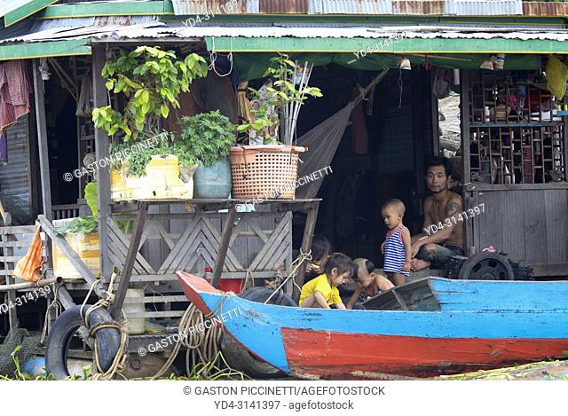 People in the houseboat, Chang Kneas floating village, Siem Reap Province, Cambodia. Chang Kneas, is one of the more than 170 villages surrounding the Tonle Sap...