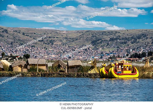Typical panther boat at the floating islands on the Titicaca lake close to Puno, Peru