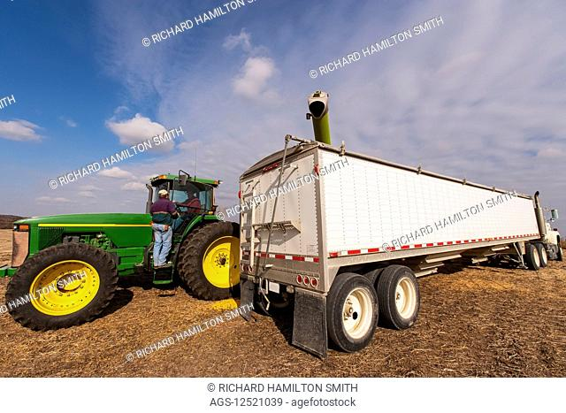 Two farmers discuss harvest during corn harvest, near Nerstrand; Minnesota, United States of America