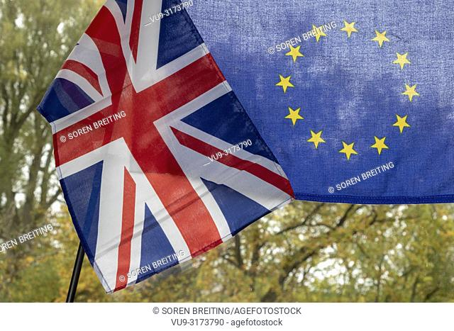 UK flag and EU flag, juxtaposed as a symbol for BREXIT negotiations in autumn environment