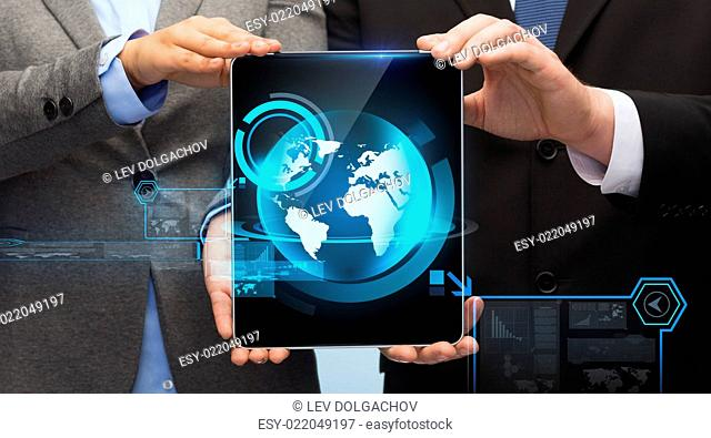 business, technology and internet concept - businessman and businesswoman with globe on tablet pc computer screen