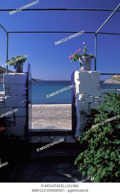 Portal of a house, plants, view of the sea, Agathonisi, Dodecanese, Greece